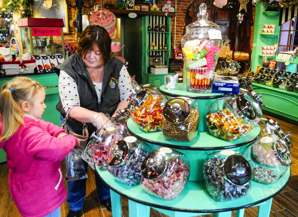 News Image: Jaylynn Tenney, 6, and her grandmother Angie Newhouse shop for candy in Scrummy Afters on Saturday on Water Street in downtown Hallowell