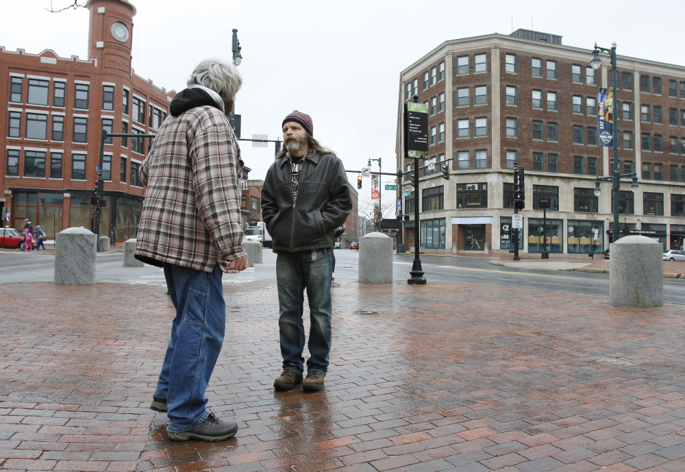 Portland Press Herald Image: Mark Perry, a peer coach at Amistad, right, speaks with Billy, left, on Friday in Portland as he walks around downtown.